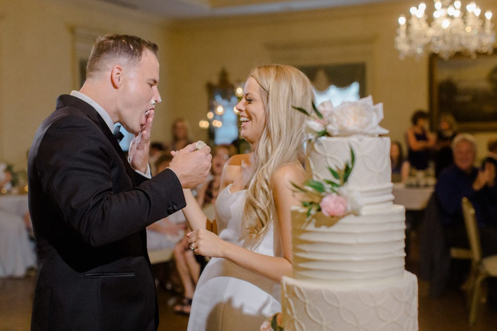 Bride and groom cutting their cake during Pittsburgh Field Club wedding