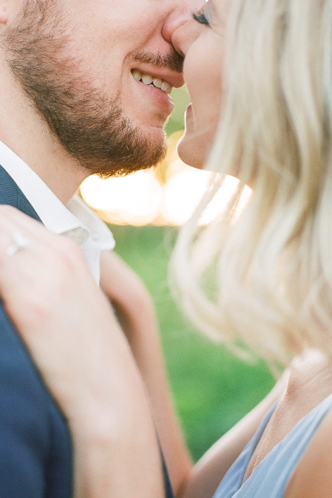 Close up of couple kissing: styled in blue engagement session