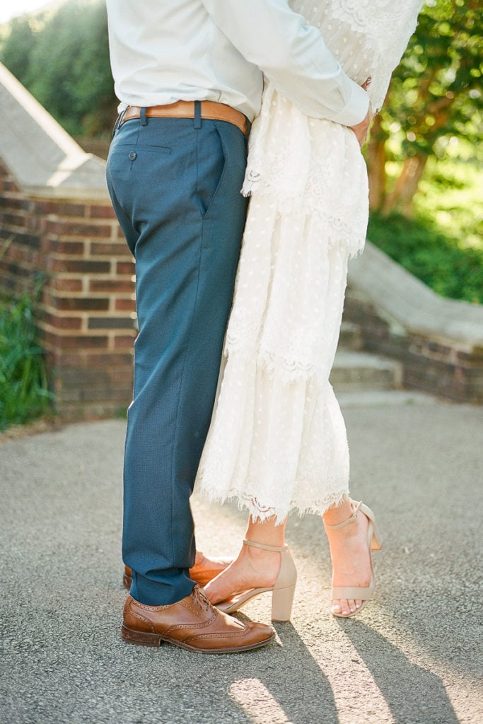 Photo of couples feet during walled garden engagement session
