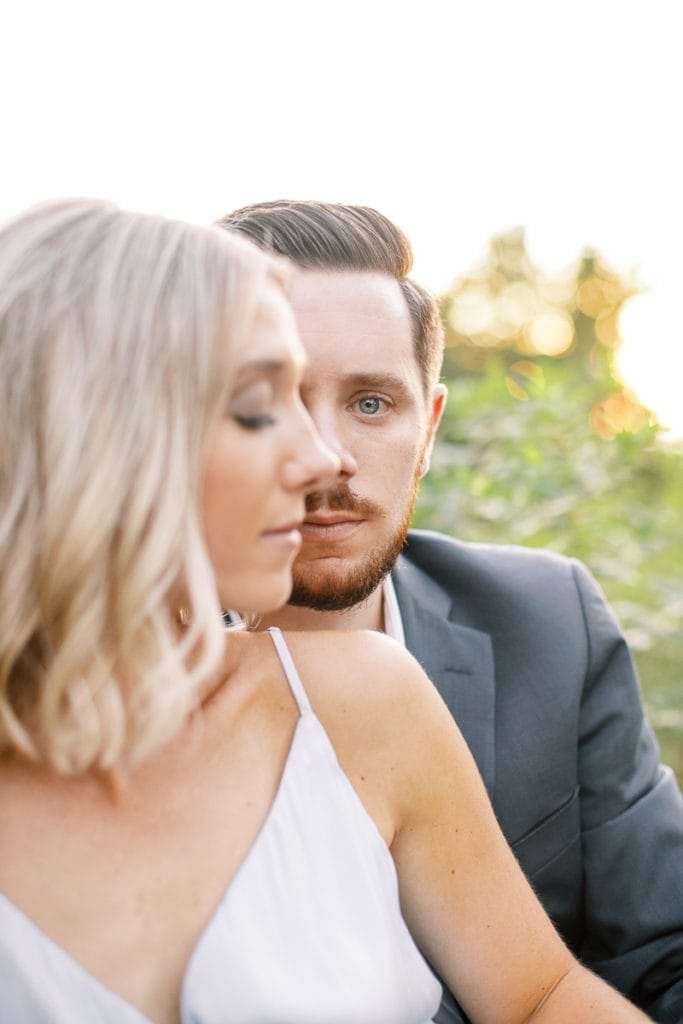 Groom's blue eyes looking into the camera during their styled in blue engagement session