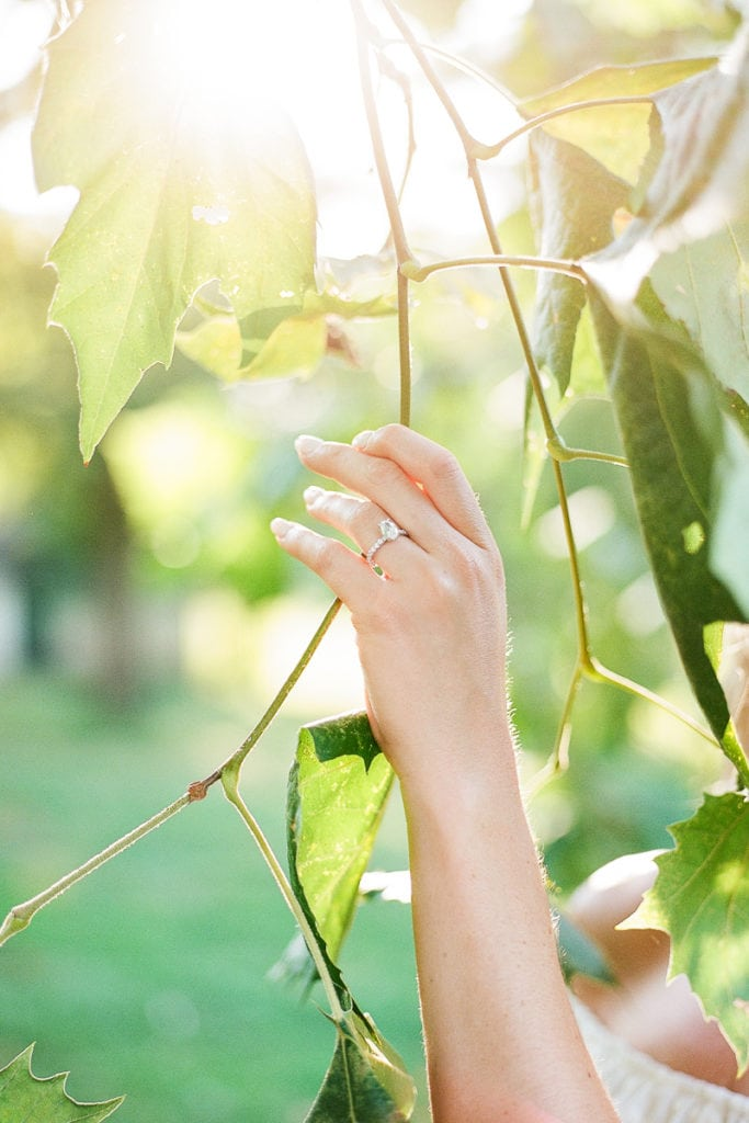 Bride delicately holding a tree branch showing off her engagement ring: Lauren Renee Pittsburgh wedding photography