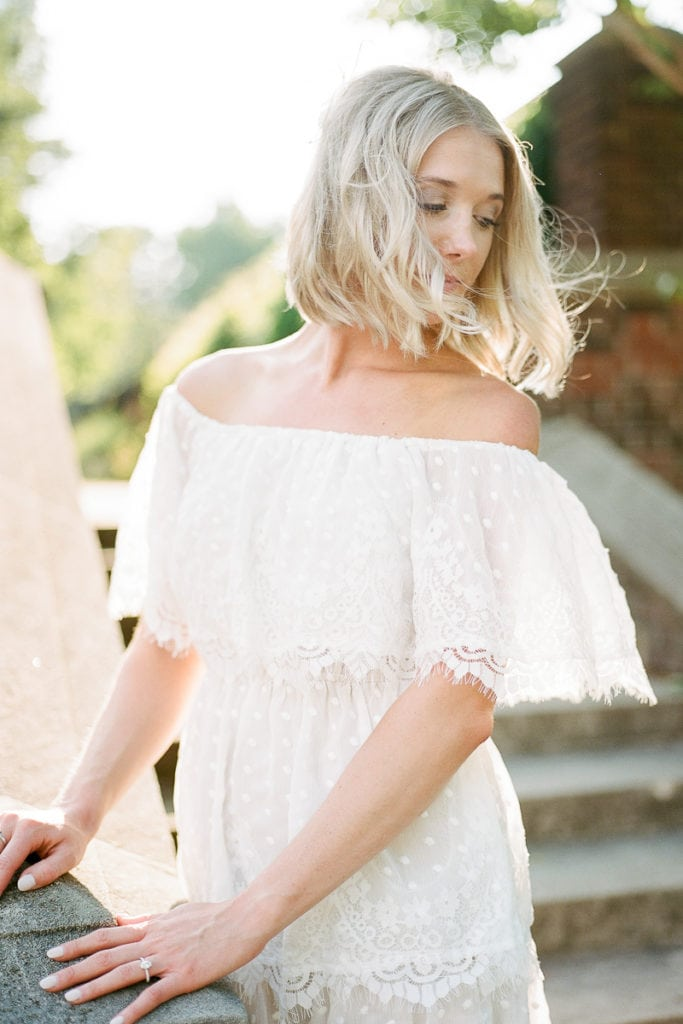 wind blowing through bride's blond short hair wearing off the shoulder white ruffled show me your mumu dress