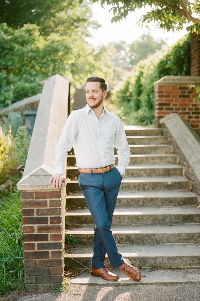 Handsome groom in blue pants and light blue button up shirt