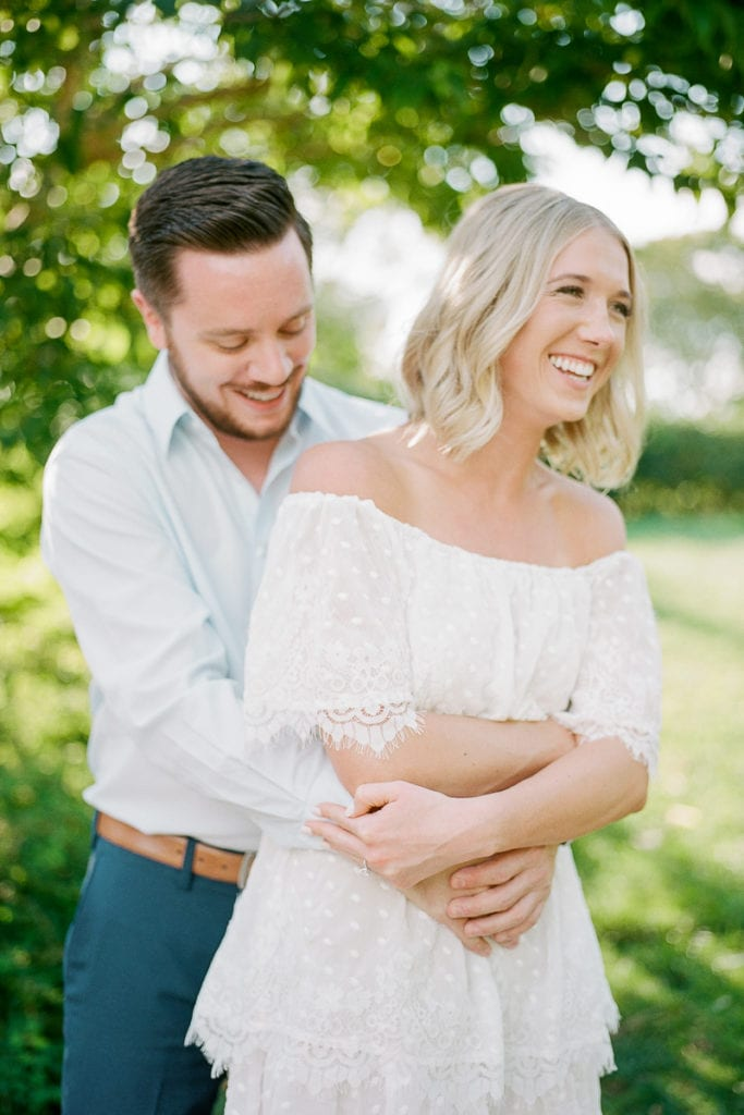 Beautiful Couple laughing during their engagement session: Lauren Renee Pittsburgh Wedding Photographer