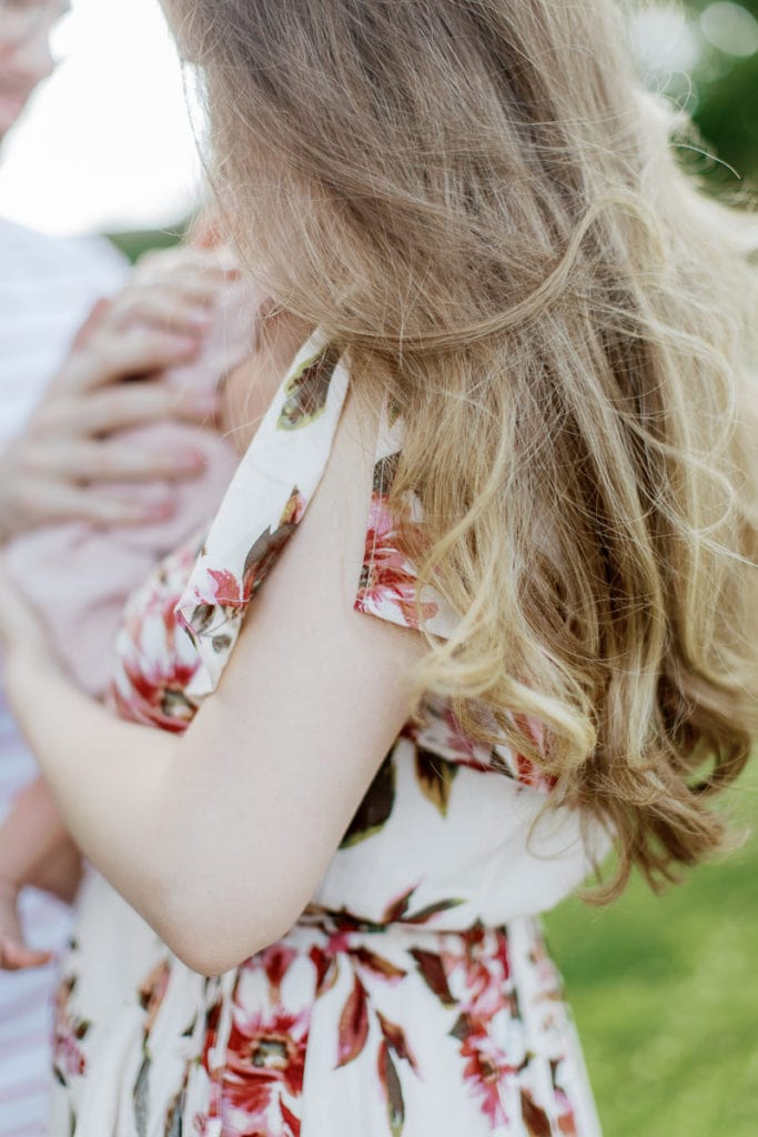 blonde hair blowing in the wind: outdoor newborn session