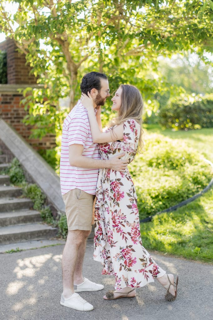 man and woman looking at each other laughing and embracing in mellon park: outdoor newborn session