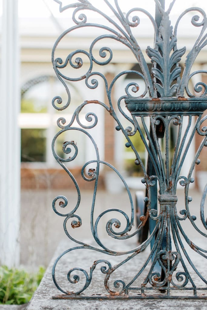 wrought iron decorative railing inside the walled english garden of mellon park: outdoor newborn session