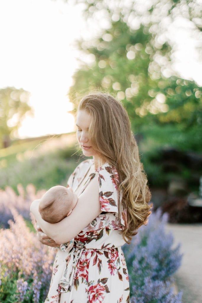 Newborn and mother walking through lavender in english garden: outdoor newborn session
