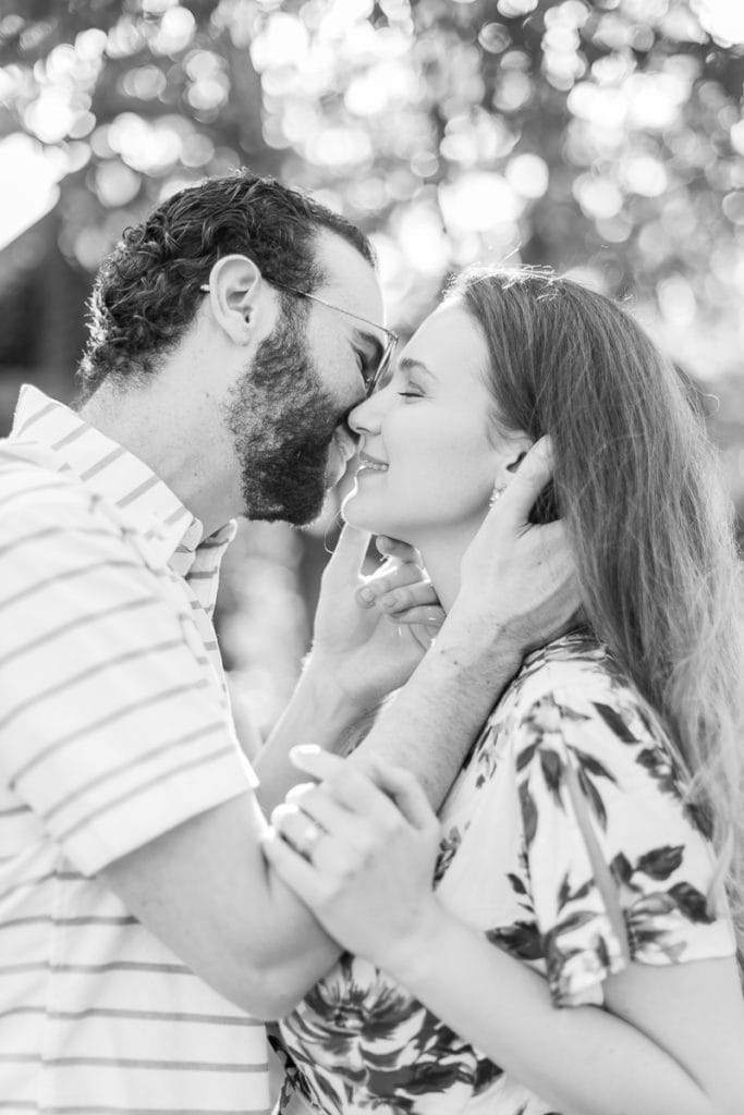 black and white image of couple kissing: outdoor newborn session