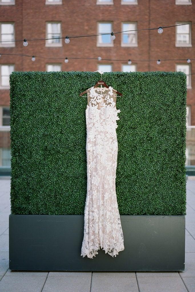 Hanging lace wedding dress