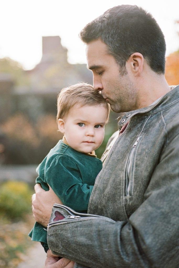 Toddler smiling during Pittsburgh family photos at Mellon Park