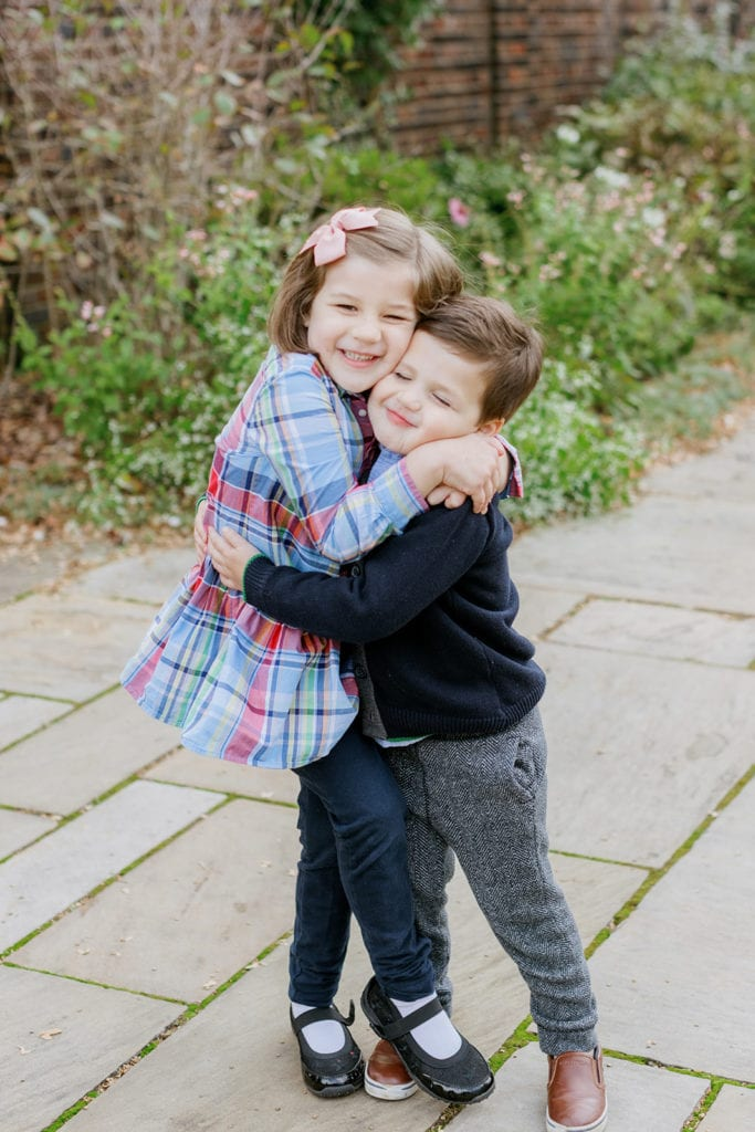 Brother and sister hugging during fall family photos