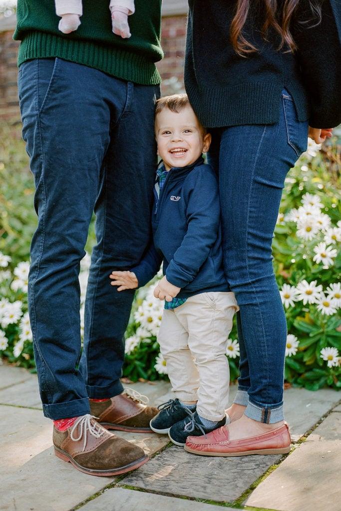 Toddler posing for fall family photos
