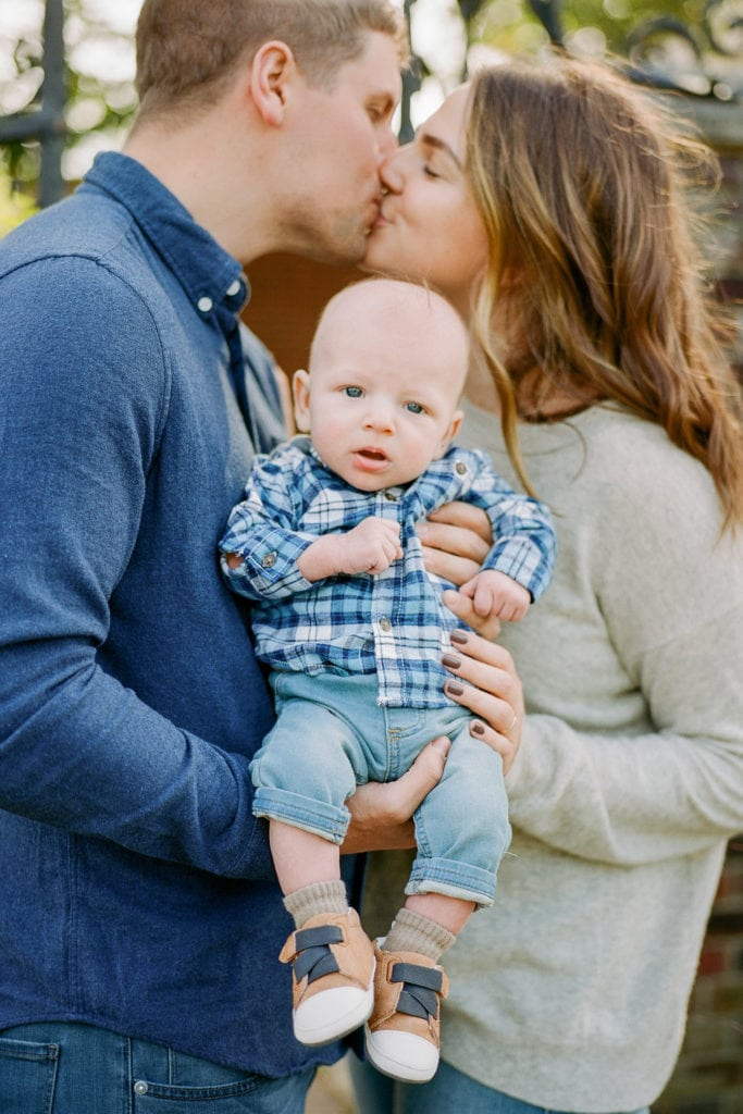 Baby dressed in blue plaid shirt for family photos