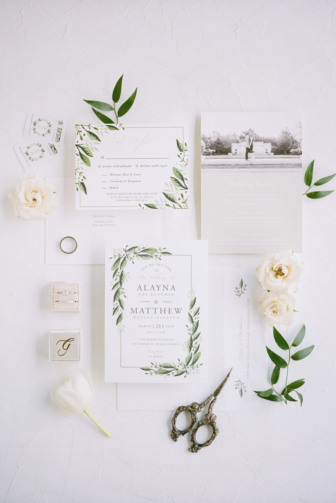 White Wedding invitation with greenery accents