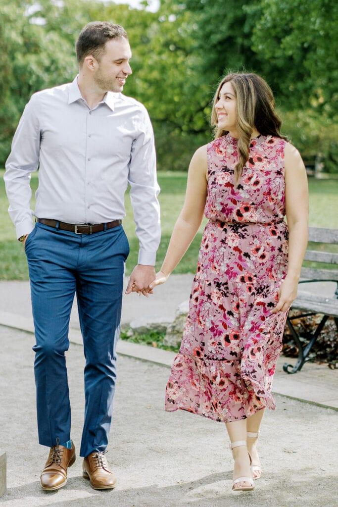 Couple holding hands through Mellon Park