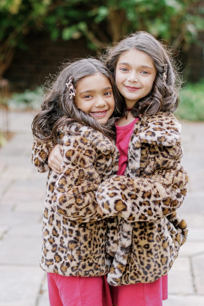 Sisters wearing matching leopard print coats