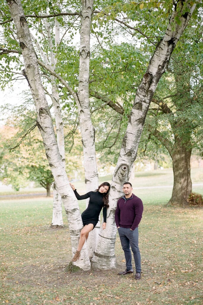 Couple posing in a tree in Mellon Park
