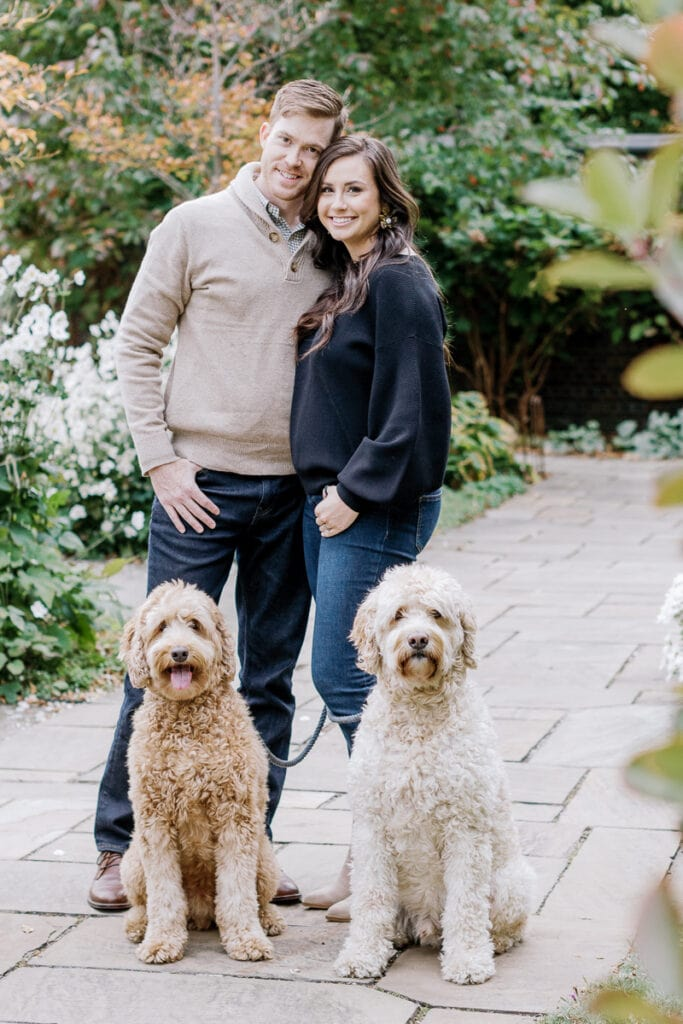 Husband and wife with their two doodle dogs