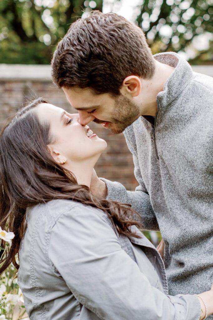 Couple kissing in Mellon Park