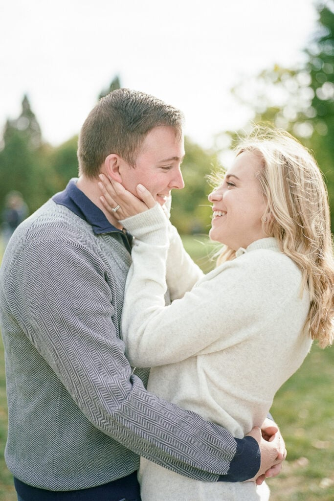 Wife grabbing her husbands cheeks
