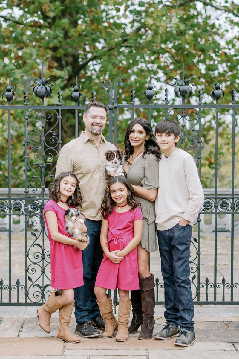 Family of five posing in front of Mellon Park gate