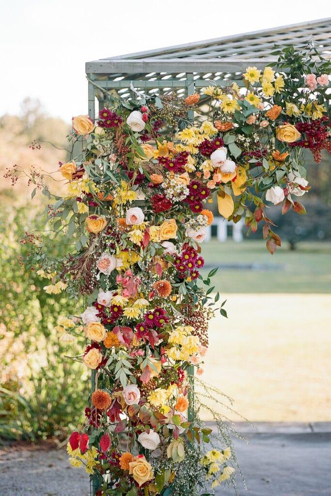 Warm colored wedding floral arch
