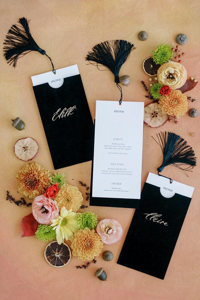 Wedding escort cards with menu inserts