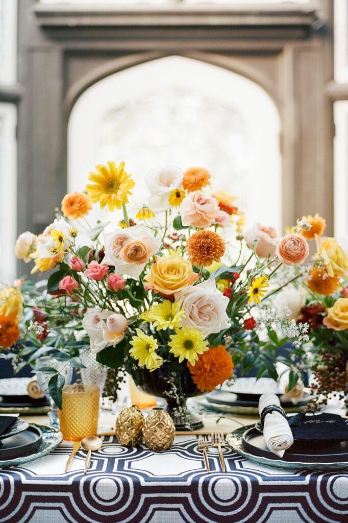 Yellow and orange wedding centerpieces