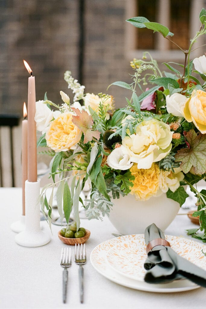 Yellow and greenery wedding centerpieces