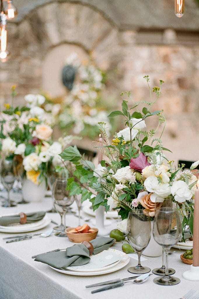Greenery and white wedding centerpieces