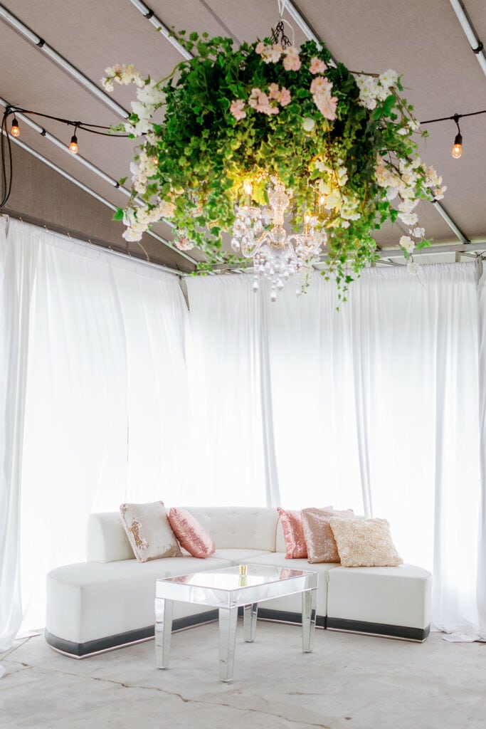 Pink and white wedding lounge area