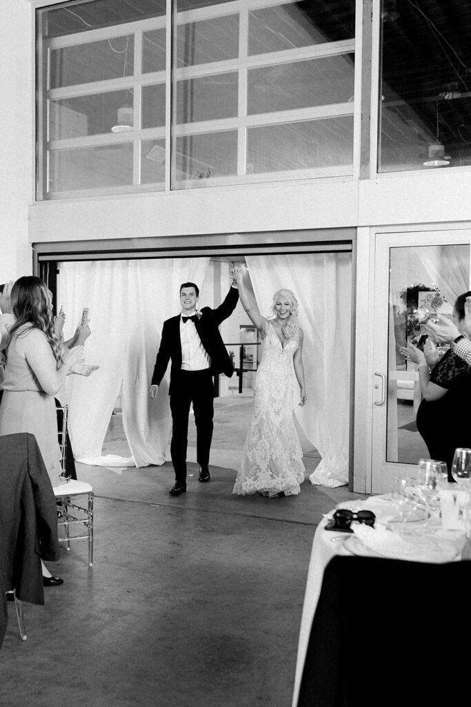 Bride and groom's grand entrance at Riverfront wedding
