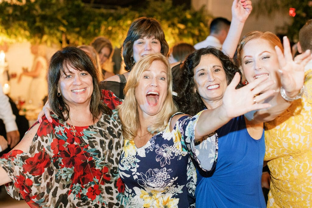 Family and friends dancing at luxe and romantic Riverfront wedding