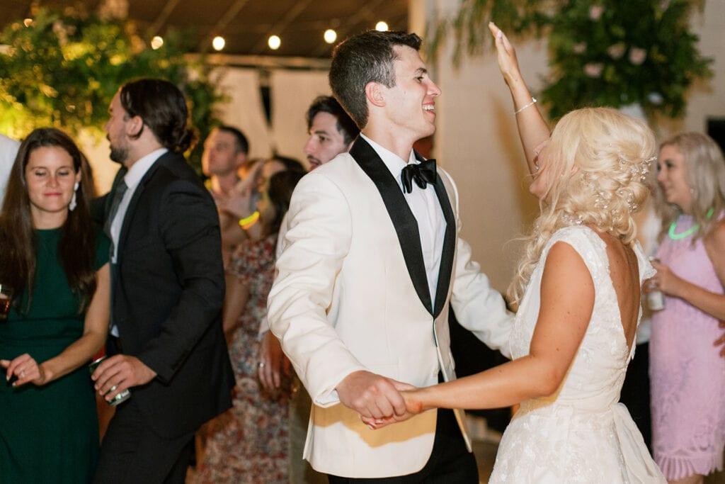 Bride and groom dancing at Riverfront wedding