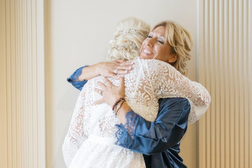 Bride hugging mother of the bride