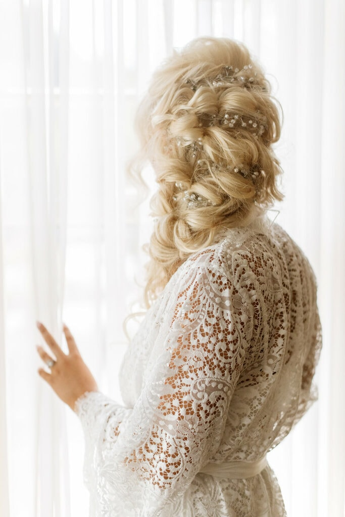Braided bridal updo with silver hair vine