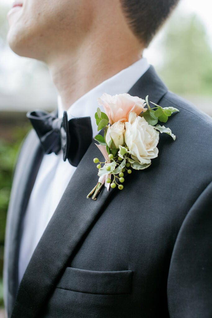 White and peach wedding boutonniere