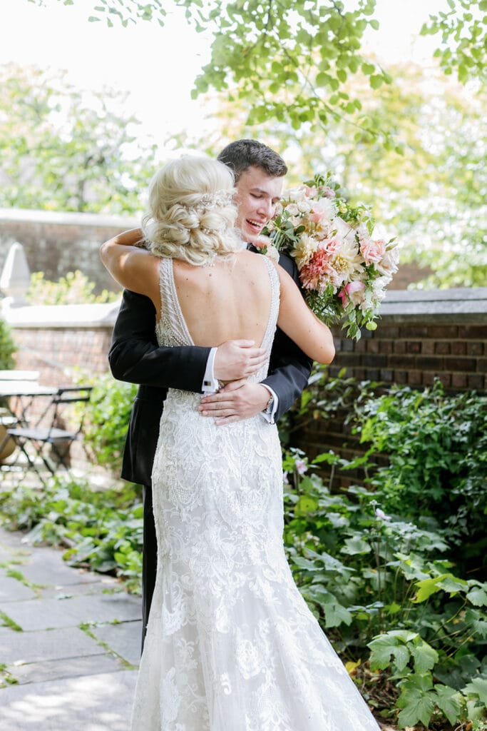 Bride and groom hugging during first look in Mellon Park