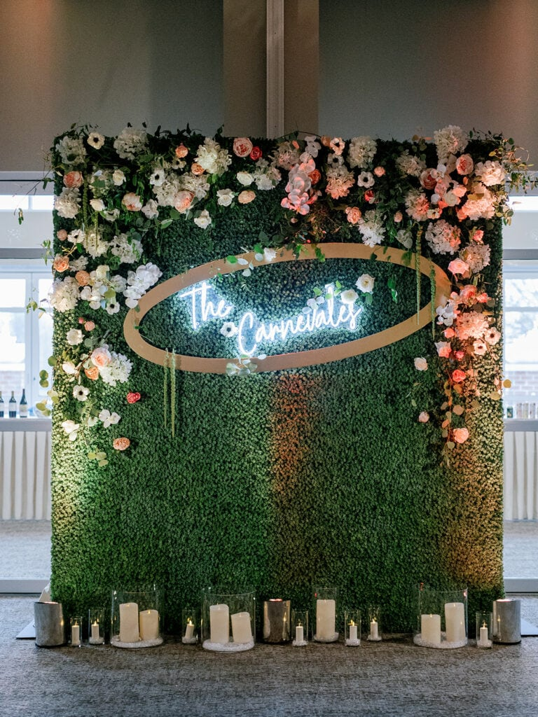 Boxwood flowers with neon wedding sign