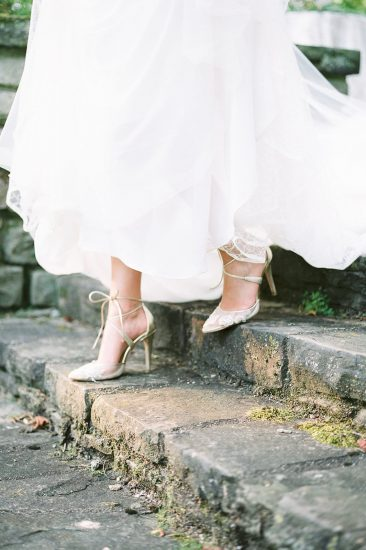bella bell shoes on bride walking down cobblestone steps