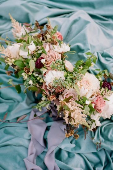 floral bouquet by emily reynolds designs with colors of mauve pink, raspberry, and blue