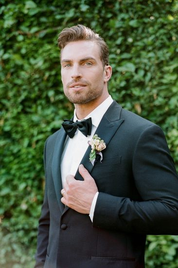 portrait of a groom on his wedding day wearing a tuxedo