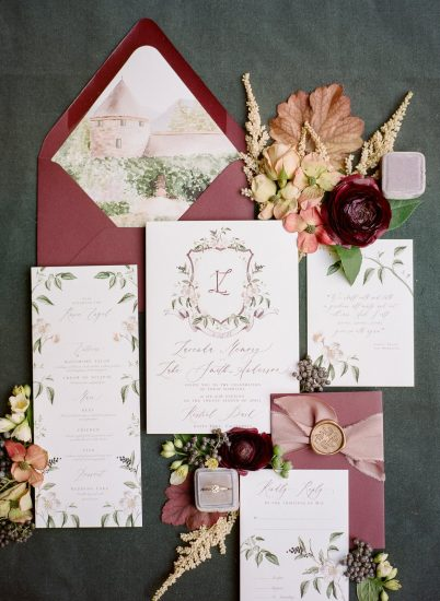 invitation design by emily mayne studios with calligraphy and water burgundy water color accents