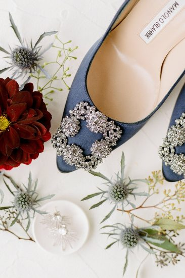 manolo blahnik navy blue pumps in wedding flat lay
