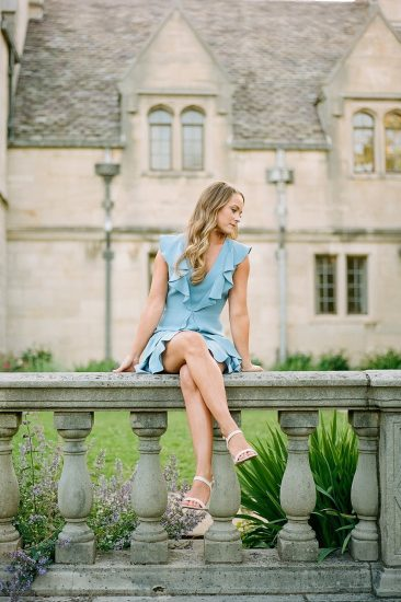 woman sitting on a railing at Hartwood Acres Mansion