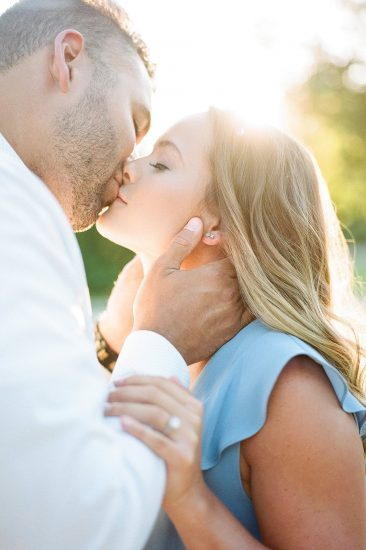 Man grabbing woman's face during passionate kiss
