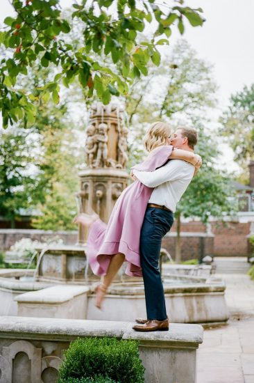 Couples at Mellon Park groom picking up bride near fountain