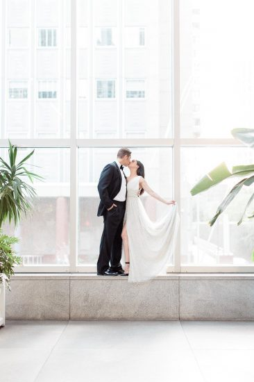 Photo of a couple standing in a large window