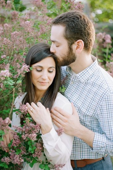 Couple posing in purple flowers
